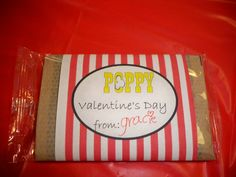 popcorn valentines. I just made a template and printed two per page, side by side on a regular sheet of paper lengthwise. then just wrapped it around a bag of microwave popcorn and used a little scotch tape to secure it in the back.