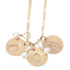 TRIPLE INITIAL NECKLACE  Because three is better than two... Sign away with this custom-made accessory that works to play-up any outfit! The personalized and hand-stamped charms provides a meaningful pendant, while the pearl additions enhances every woman's effortless beauty.  Description: 14K gold filled necklace and hand stamped charms with petite mother of pearl. Necklace measures 16 or 18 inches in length.