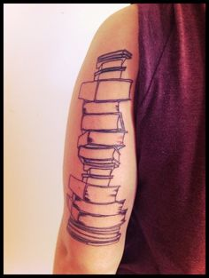 "Book tattoo        ""Books are the quietest and most constant of friends; they are the most accessible and wisest of counselors, and the most patient of teachers.""  Reading was my first love in life. I started at an early age, consumed hundreds of books as a child, and now I am a minor in Fiction Writing. This is the start to a half sleeve dedicated to my love of reading and writing.  kitten roar"