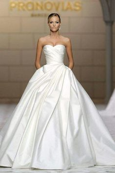 Stunning Atelier Pronovias Wedding Dresses - MODwedding This is utterly elegant and graceful. I love ball gown wedding dresses! Makes me feel like id be a princess and im hoping to be a princess and have my fairytale dream wedding one day! Elegant Wedding Dress, Dream Wedding Dresses, Bridal Dresses, Wedding Ball Gowns, Plain Wedding Dress, Princess Ballgown Wedding Dress, Winter Wedding Dress Ballgown, Elegant Dresses, White Wedding Dresses