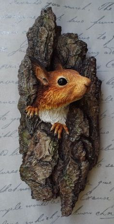 This British wildlife sculpture shows a life size Red squirrel; 'Hope', peeping out from a hole in a Pine tree and is designed as a wall mounted sculpture for inside. The original for this wall art piece was sculpted in wax and moulded, then each one o. Tree Carving, Wood Carving Art, Wood Carving Patterns, Wildlife Art, British Wildlife, Red Squirrel, Wood Creations, Driftwood Art, Wooden Art