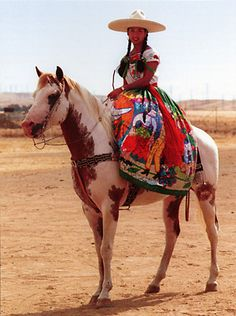 a Mexican charra (rodeo cowgirl)