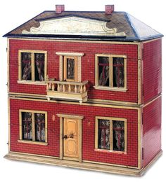 antique dollhouse, old brick simple look. Don't know the maker or age.  .....Rick Maccione-Dollhouse Builder www.dollhousemansions.com