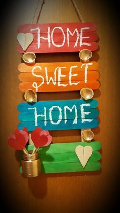 10 Different Pieces Of Wall Art To Replace Your Tapestry - Society19 Popsicle Stick Crafts For Adults, Diy Popsicle Stick Crafts, Diy Crafts For Adults, Diy Projects With Popsicle Sticks, Craft Stick Projects, Paint Stick Crafts, Craft Projects For Adults, Craft Sticks, Wooden Projects