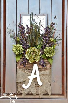 Baskets of flowers for the dining hall doorway with monogram? Or just monogram initials made out of flowers?