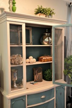 Unique hutch; I could do this with mine, take glass out replace with wire mesh, paint doors and back turquoise.