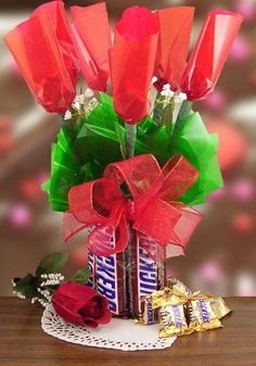 Calling all snickers candy bars lovers! We have created a special Valentine's Day Snickers candy bar bouquet for you! If you have a Snickers candy bar lover on your Valentine's Day list, this will satisfy the need for those candy bars! Made with five snickers bars as the base and six mini Snicker...
