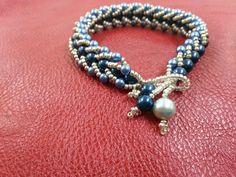 Beutiful flat spiral bracelet with swarovskyi crystal pearls.