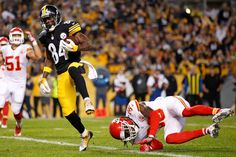 STEELERS 43  -  CHIEFS 14  -     Pittsburgh Steelers wide receiver Antonio Brown scores on a pass from quarterback Ben Roethlisberger, with Kansas City Chiefs free safety Ron Parker defending during the first half of an NFL football game in Pittsburgh, Sunday, Oct. 2, 2016.
