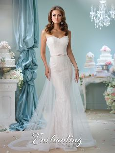 Strapless sweetheart tulle and lace slim A-line cage gown, natural waist belt with center bow, slim skirt features a tulle A-line overskirt with narrow horsehair hem and chapel length train. Removable straps included. Sizes:0 – 20 Colors:Ivory/Pearl, Ivory, White