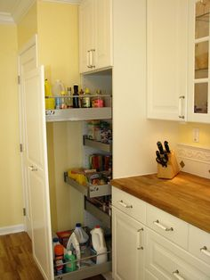 love the butter yellow with the butcher block.