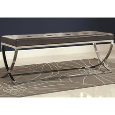 Accent your room with sophistication and elegance. This tufted bench features a sleek chrome metal base with crossing legs, The tufted seat is upholstered in a black leatherette for supreme comfort and style. Its design and color blend in with many decors