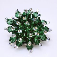 Make a statement and add some glitz with this sparkly fun crystal bead brooch. This neat little brooch is hand made from faceted sparkly green crystal beads which are individually strung onto a silver plated brooch base and secured with silver line. Crystal Beads, Crystals, Beaded Brooch, Organza Gift Bags, Seed Beads, Bling, Green, Silver, How To Make