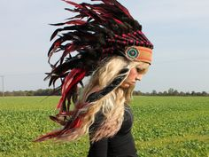 etsy custom leather and feather headdress...i might make an appearance in this bad boy sometime