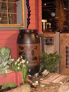 simple yet lovely rain barrel design and ALSO a pretty recycled rain chain made of glass bottles