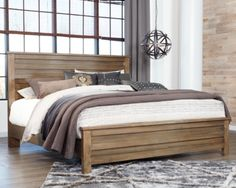 Morraly California-King Poster Bed by Ashley HomeStore, Grayish Brown
