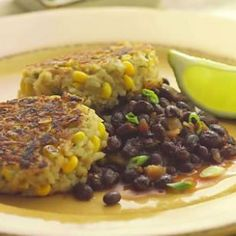 Rice and Corn cakes with Spicy Black Beans. Vegan. Author says it was a kid pleaser too :) (Scroll towards bottom to find recipe on the blog.)