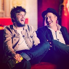Winston Marshall and Marcus Mumford of Mumford & Sons relaxing before theirsecret show for The Artists Den at The Belasco in Los Angeles on November 11, 2012.  Photo © Colin Young-Wolff.