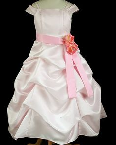 Reina: Long Satin Junior Bridesmaid Flower Girl Dress in PinkReina : Long Floor Length Pink Flower Girl Junior Bridesmaid Dress This dress features a cinched pick up style that covers the entire gown. The long dress is fully lined and cut to fall down to the floor. This dress is made from heavy wedding quality dull satin and has an attached satin sash.