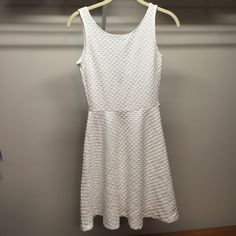☀️ H&M textured sun dress Simple white dress with fun textured pattern. I have the same dress in red (pictured) and I love it! This one is a bit see-through so you'll definitely want to wear nude panties underneath  H&M size 6 so would fit anyone size XXS/XS. H&M Dresses