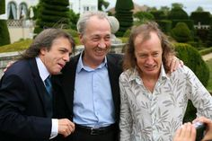 Brothers Malcolm Young, George Young and Angus Young, 2012