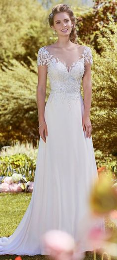 Lightweight wedding dress Mercy by Rebecca Ingram featuring beaded lace motifs and chiffon skirt. Swarovski crystals adorn the bodice of this romantic sheath. #affordableweddingdress #budgetbride #lightweightweddingdress