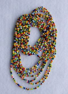 """Love Beads"" - handmade.  A bit of the 60's brought back in style! Handmade beaded love beads created with multi-colored glass seed beads strung on 20# test Beadalon Dandyline beading string. My love beads are sold 3 strands to an order: 1 strand 36"" love beads, 1 strand 38"" love beads, 1 strand 48"" love beads"