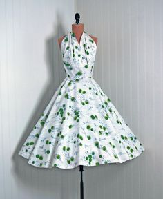 Vintage 1950s halter dress with the sweetest dandelion print in a chartreuse and green.