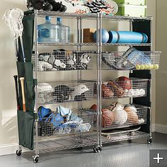 Chrome Sports Shelving at Frontgate.com. Pull out bins are a great idea.