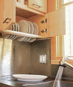Dish drying cupboard above the kitchen sink. Saves space and reduces clutter.