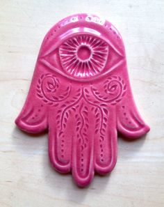 Carved Hamsa wall hanging from Fern Street Pottery