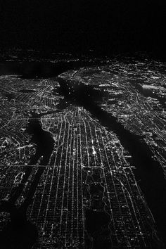 New York City  /  Mahattan Island in center looking south at night; Brooklyn to left and New Jersey to right.