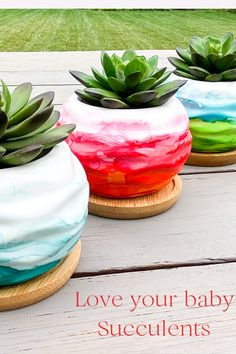 """Mini Succulent planters in some vivid colors that are perfect for small succulents, other plants or used to hold miscellaneous items on top of a desk. Water geometric design with drainage hole and bamboo tray. Each is painted with alcohol ink (turquoise and lime green) (orange and pink) and (Blueish Green). These ceramic planters have been treated with several layers of sealant and UV protectant. It is 3.7"""" across it's widest point and is 2.36"""" tall."""