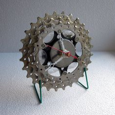 This desk clock is made from a recycled bicycle cassette carrier that was cleaned by hand using biodegradable degreasers and cleaners. The custom made cradle is constructed from a green recycled bike spoke and uses a black anodized nipple. The clock measu White Clocks, Unique Clocks, Desk Clock, Biodegradable Products, Upcycle, Recycling, Hands, Deep, Cleaning