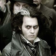 Johnny Depp rockin' his skunk hair in Sweeney Todd. Seriously, this man can make anything look good, even a crazy murderous butcher.