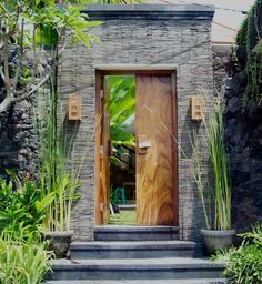Street entrance gate idea.Love the color of wood and color of stone