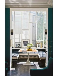 """In this little sun room are arranged, from left to right, a photo by Miguel Rio Branco, one of Charlotte her 5:55 album and one by Pierre Molinier. The U-shaped seat is covered in a black-and-ecru wool by Florence Lopez The February 2014 issue of """"The World of Interiors"""" Magazine features a great article on Charlotte Gainsbourg and Yvan Attal's apartement in Paris. Have a look, it's gorgeous! #charlottegainsbourg #yvanattal #florencelopez"""