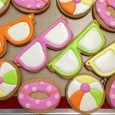 Sunglasses, beach ball, floaties sugar cookies #polkadotscupcakefactory