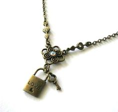 Bronze lock and key necklace with arrow heart