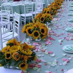 I like the way they lined up the low-profile sunflowers on this head table.  Not sure if you want a head table though