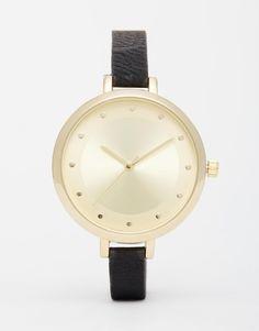 €32, Reloj de Cuero Negro y Dorado de Asos. De Asos. Detalles: https://lookastic.com/women/shop_items/327956/redirect