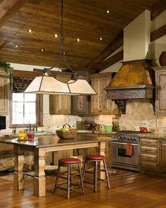 Small and cute rustic kitchen in this Montana guesthouse, built by Montana Build, Inc. Whitefish, Montana--love the hood