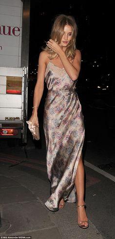 Rosie Huntington-Whiteley flaunts her lithe legs in sultry slip dress