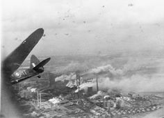 The Goldenburg power station at Knapsack, near Cologne, under attack by Bristol Blenheim Mark IVs of No. 2 Group. On the left, Sergeant I Broome, flying V6391 'RT-V' of No. 114 Squadron RAF, banks steeply away after bombing as flak fills the sky over the target.