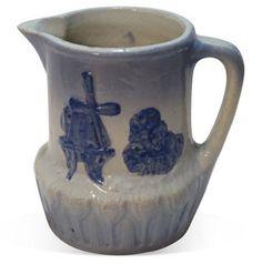C. 1900, American Stoneware Milk Pitcher    $195.