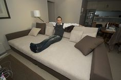 King size bed turned into a couch. I love this idea, I need a couch, this might be one hell of an idea!!!