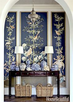 Beautiful entry by Summer Thornton foyer in House Beautiful- photo: Luke white | Love the Chinoiserie panels, blue and white porcelains and ming console table.
