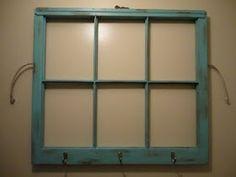 Coat hanger on old window.