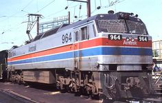 (E60CH).  Amtrak #964     G.E. E60CH - with newer head-end power (HEP) generators for the Amfleet.  Cab and pantograph at each end. (AAR) C-C.  5100 H.P.. Built 1974-76