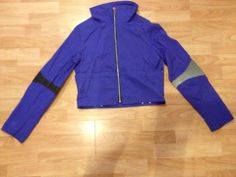 Purple hoodie with black/ silver elbows and glow zip.
